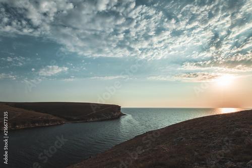 Fotobehang Grijze traf. Brilliant vacation destination beach sunrise and sea cliffs background