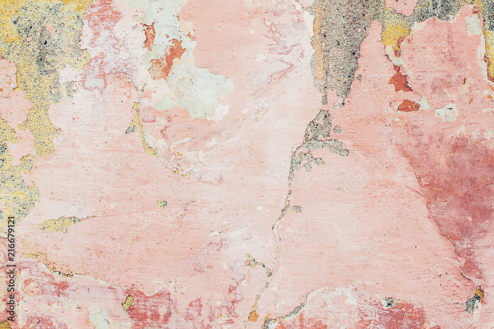 Fototapety, obrazy: Old colored cracked wall. Grunge wall texture for design. Colored cracked background. Old paint texture is chipping and cracked fall destruction. Background of old pink painted wall.