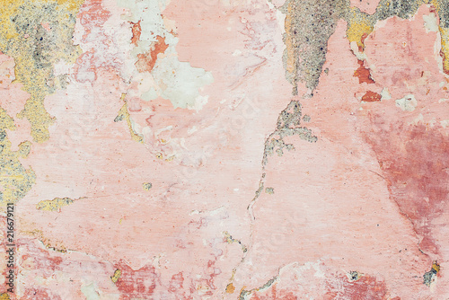 Poster Wand Old colored cracked wall. Grunge wall texture for design. Colored cracked background. Old paint texture is chipping and cracked fall destruction. Background of old pink painted wall.