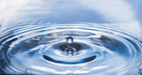 water drop and splash on surface make circle wave, abstract background