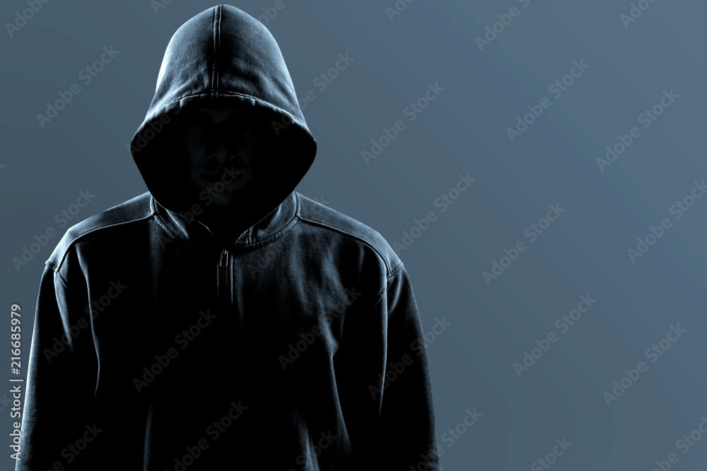 Fototapeta Thief in black clothes on grey background