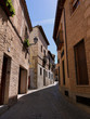 A narrow winding laneway in the medieval city of Toledo Spain