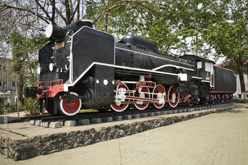 Steam locomotive near railway station in Yuzhno-Sakhalinsk. Sakhalin island. Russia