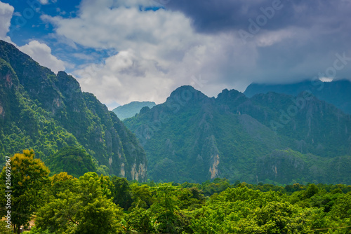 Fotobehang Groen blauw Landscape of mountains and clouds Green tree in the rainy season