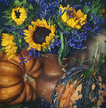 Autumn Still Life. Autumn Bouquet Of Flowers With Sunflowers And Leaves On A Dark Background.