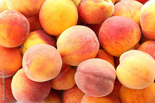 Fresh sweet peaches as background