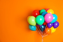 Bunch Of Bright Balloons On Color Background With Space For Design
