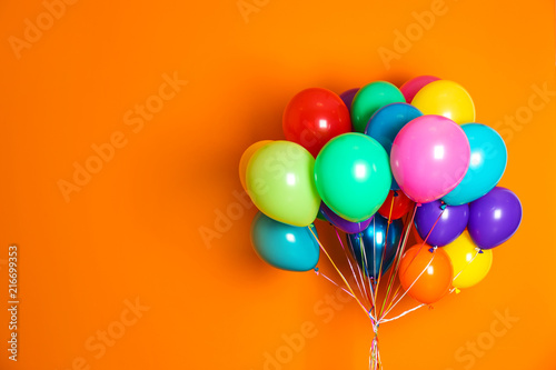Obraz na plátně  Bunch of bright balloons on color background with space for design