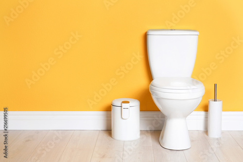 Photo  New ceramic toilet bowl in modern bathroom with space for text