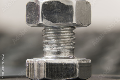 macro photo of silver bolt with nut