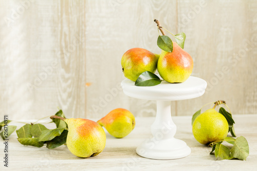 Many juicy beautiful amazing nice pears on light wooden background Canvas Print