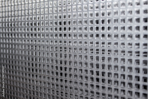 Fotografia, Obraz  Perforated metal plate steel sheets with grid pattern with abstract grid pattern