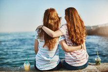 Girs Making Promises Never Leave Each Other, Gazing At Beautiful Sea And Hugging, Sitting Near Docks, Dreaming About Future, Talking Casually Like Sisters And Enjoying Warm Sunny Evening Together