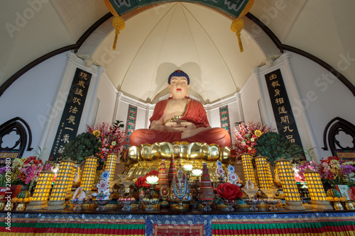 The twenty-one foot high sitting statue of Amitabha Buddha in Hua Zang Si Buddhist Temple is extremely dignified-looking and has amazed the world Wallpaper Mural