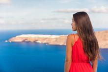 Santorini Greece Travel Luxury Destination Asian Woman Beauty At Oia Landscape Background. Tourist Girl On Holiday.