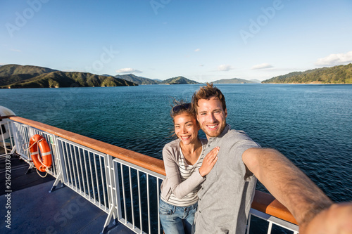 Fotografie, Obraz Cruise couple tourists taking selfie on New Zealand travel