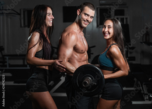 Foto op Plexiglas Fitness group with dumbbell weight training equipment on sport gym.