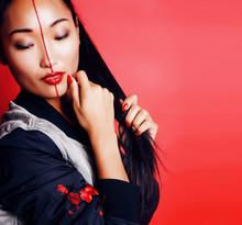 Young Pretty Asian Girl Posing...