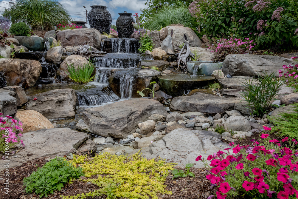 Fototapeta Landscape architecture with water features for summer garden