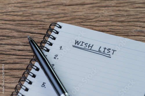 Wish list concept, pen on white paper note pad with handwritten headline as Wish Poster