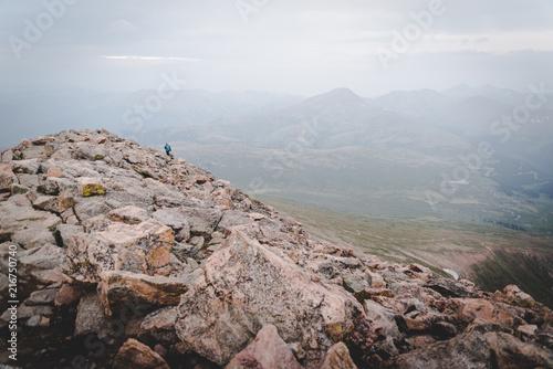 Fotobehang Bleke violet A person hiking on top of Mount Bierstadt in Colorado.