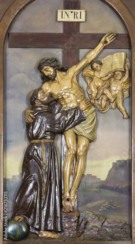 REGGIO EMILIA, ITALY - APRIL 12, 2018: The relief Jesus Christ on the Cross Embracing St. Francis of Assisi in church Chiesa dei Cappuchini.