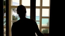 Silhouette Of Girl Opening The Doors To The Beach In Mexico