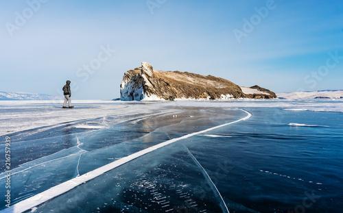 Foto op Plexiglas Asia land Travelling in winter, a man walking on frozen lake Baikal in Siberia, Russia
