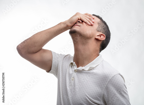 Photo  Man covering his face with his hand on white