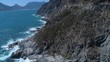 Drone flying above dramatically rugged coastline of Cape Peninsula - Chapman's Peak Drive, South Africa
