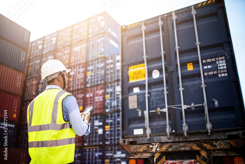 Photo Foreman control loading Containers box from Cargo freight ship for import export