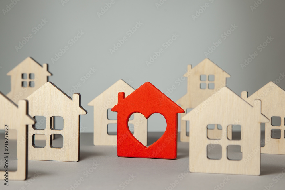 Fototapety, obrazy: Search and selection of homes for purchase or rent. Many house and one red with heart