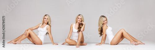Fototapeta premium Dopasowana, piękna i sportowa kobieta w białej bieliźnie. Dziewczyna z perfect ciałem pozuje w swimsuit.