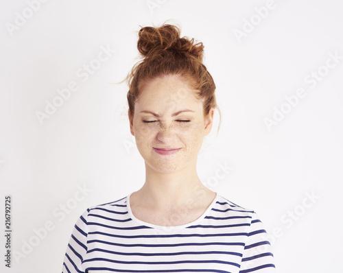 Fotografie, Tablou  Portrait of girl showing feeling of disgust at studio shot