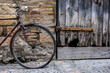 Old bicycle recharged on a rustic wall in a village street of medieval origin in the village of Alquezar in the province of Huesca in Aragon Spain Europe