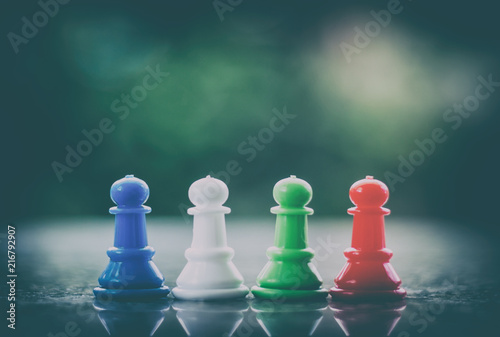 Fotografie, Obraz  Chess pawn on dark tone background for teamwork and business strategy concept