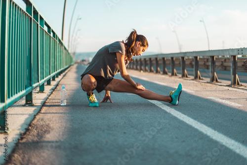 Cuadros en Lienzo Stretching before exercising