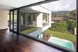 Leinwanddruck Bild - Large window in hallway of modern villa overlooking the private pool