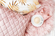 Bedding with a stylish pink pillows and cup of coffee. Copy space. Flat lay, top view