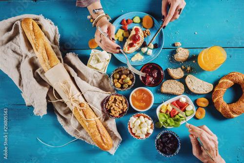 Fototapeta Delicious traditional turkish breakfast on blue wooden table obraz