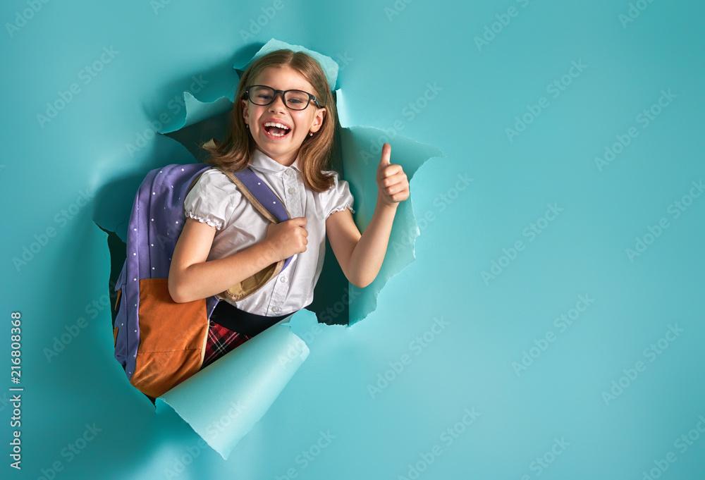 Fototapeta child breaking through color wall