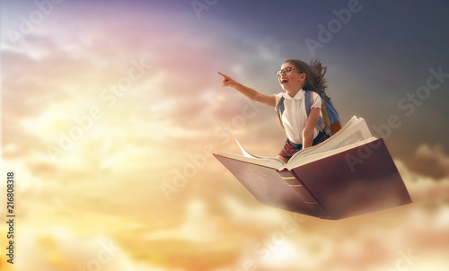 child flying on the book