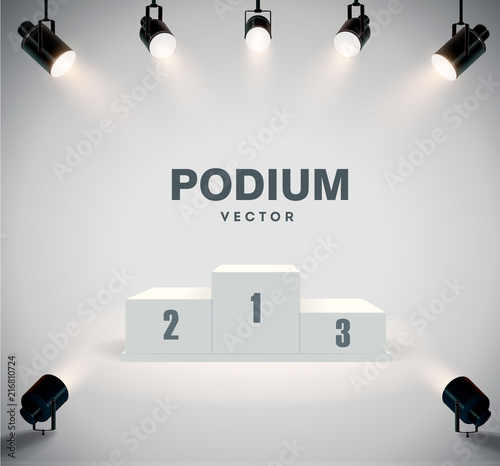 Foto Round podium illuminated by searchlights