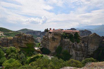 Fototapeta na wymiar The Meteora is a rock formation in central Greece hosting one of the largest and most precipitously built complexes of Eastern Orthodox monasteries. It is included on the UNESCO World Heritage List.