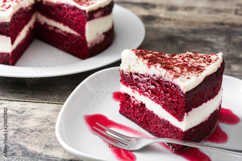 Red Velvet cake slice on wooden table