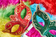 Top view, Closeup red and green venetian masquerade, Carnival mask, opera mask on colorful fluffy