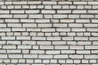 building construction: white brick wall texture - stained bricks bonded with cement