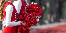 Cheerleaders With Pompoms During Game