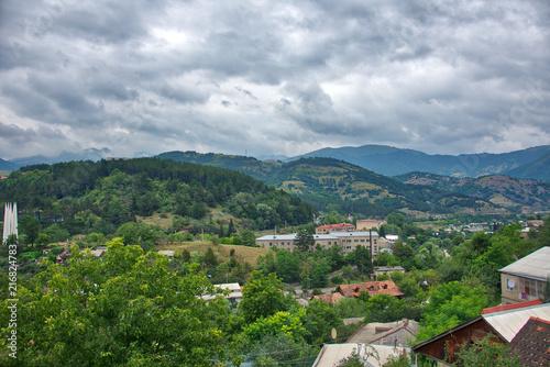 In de dag Bleke violet Mountain landscape view with part of village