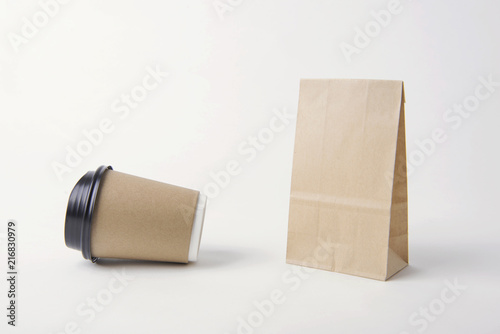 Blank brown paper bag and coffee cup for mockup template advertising and branding background.